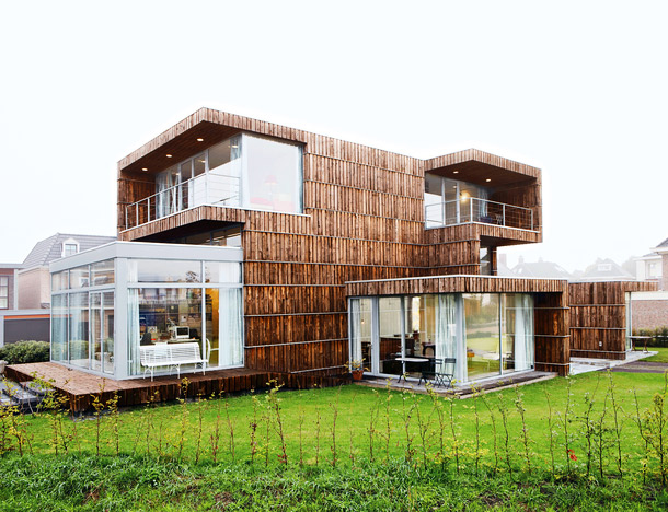Modern Dutch House Built From Salvaged Billboards and Umbrellas