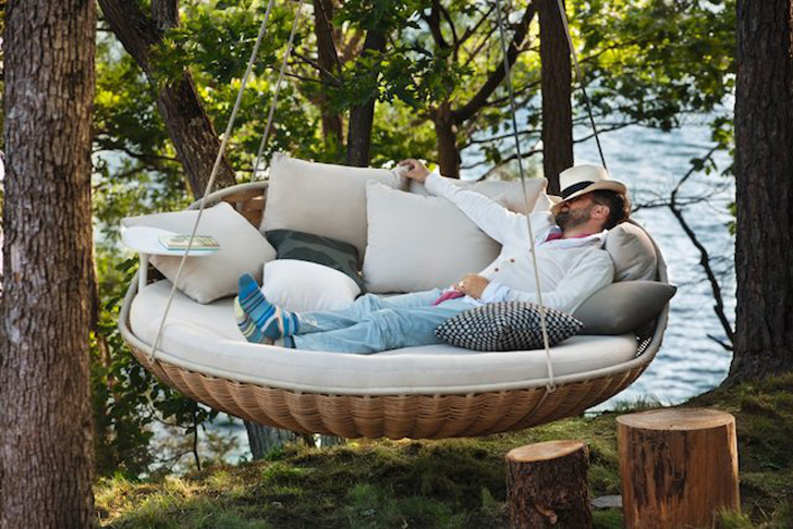 swing chair with stand outdoor bedroom yellow swingrest hanging lounger is a floating basket-like nest for an entire family | inhabitat ...