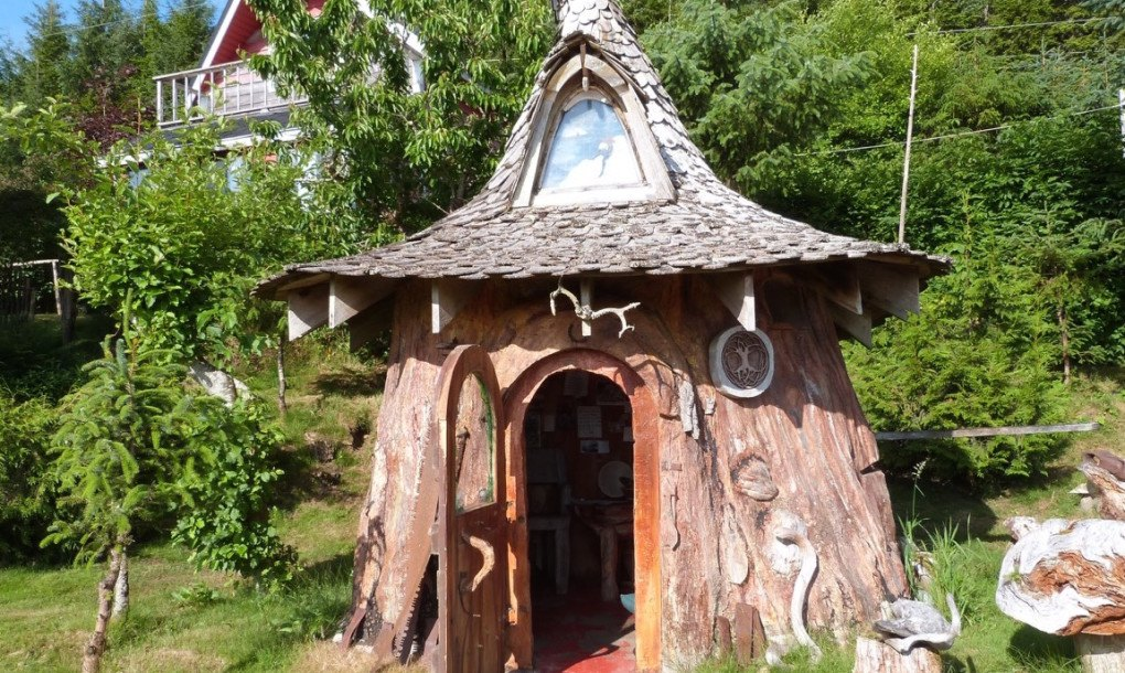 Tiny hobbit home carved from a stump is straight out of a fairytale  Inhabitat  Green Design