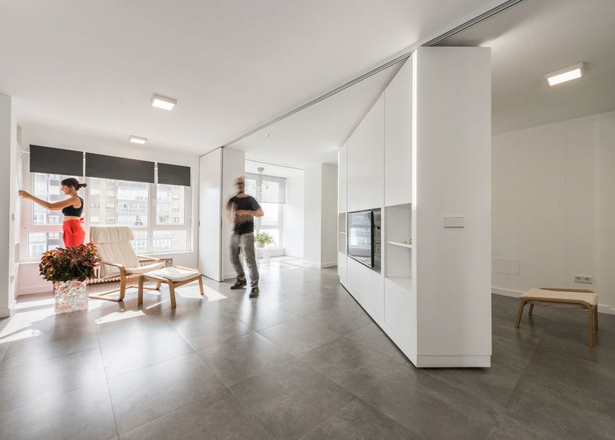 Rotating walls and transformable furniture make two rooms vanish in the Little Big MJE House