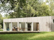 Blissful timber holiday home blends in with France's ...