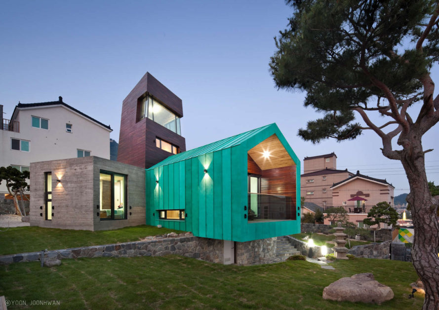 This bright teal tiny house features an observation tower