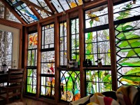 Artist builds incredible stained-glass cabin in the middle ...