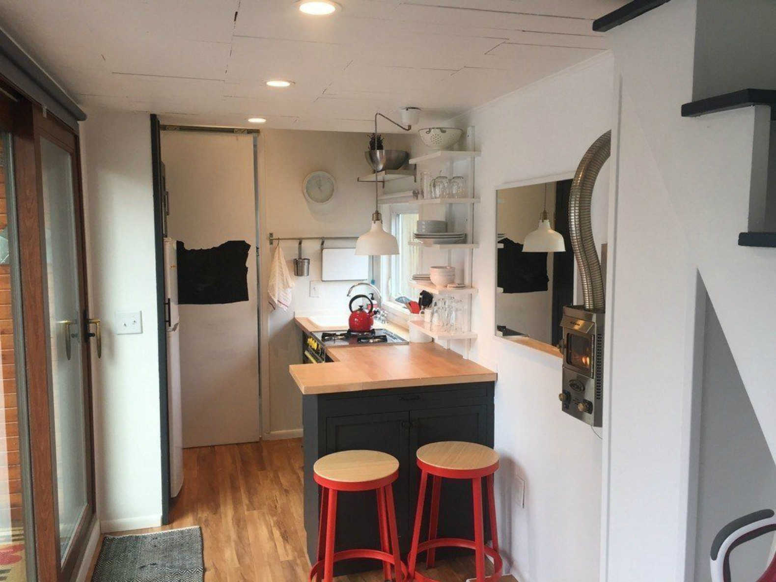 This amazing lightfilled tiny house packs big style for