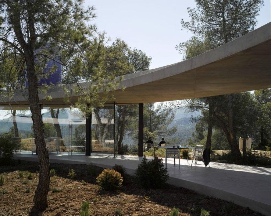 Glass-encased Circular Solo House Snakes Through A Spanish