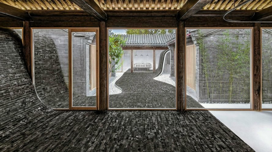 This mindblowing homes undulating courtyard lifts up to