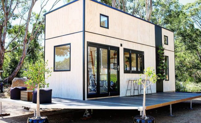 This Tiny Home Is Afforded Extra Space Thanks To A Large Deck