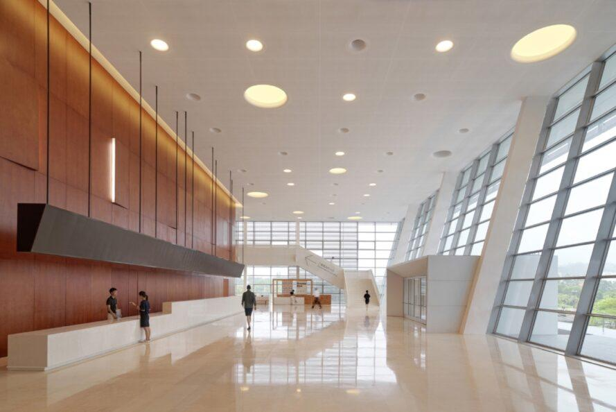 large open interior with glass walls and round lights