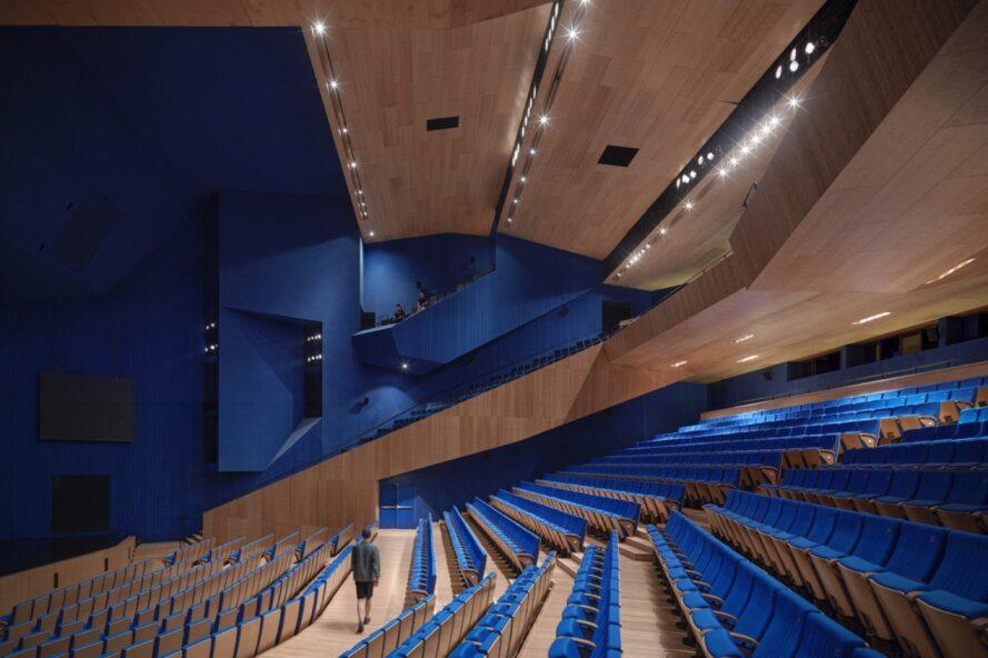 theater with blue seats and wood walls
