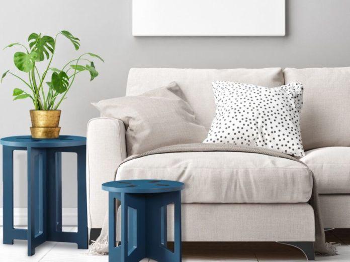 Small blue end tables near white sofa