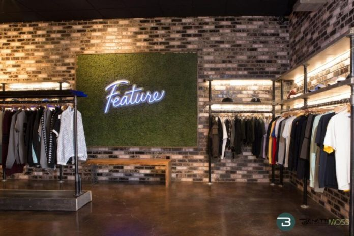 Moss wall with neon sign in a clothing store