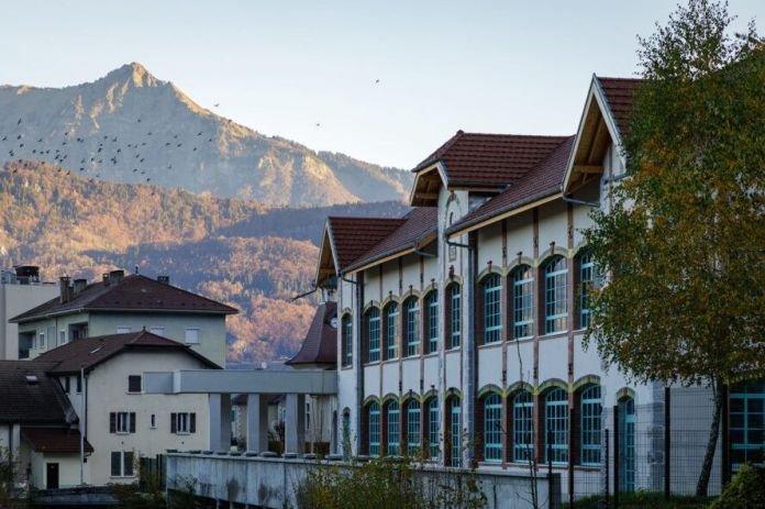 old white gabled building in mountainous landscape