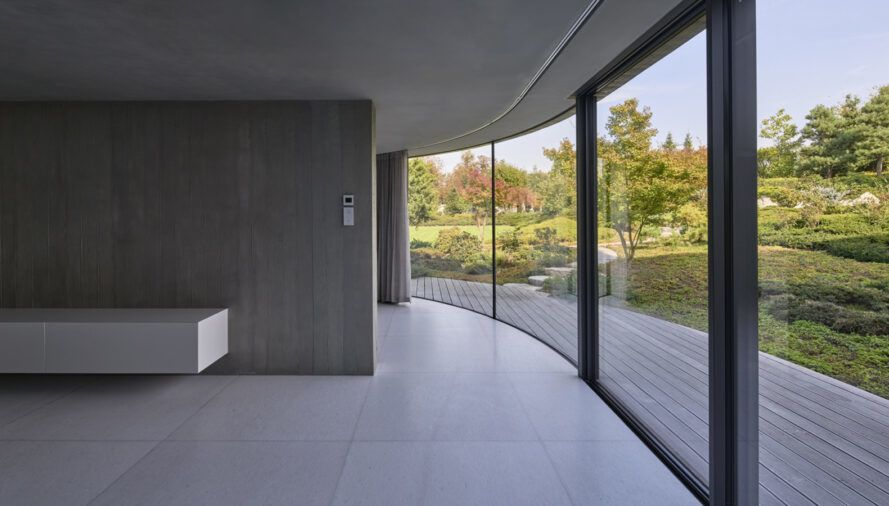 gray room with one glass wall leading to outdoor patio