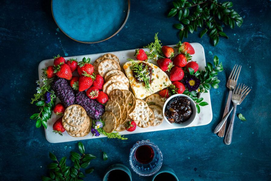 platter of cheeses and fruits