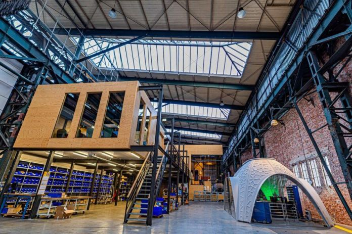 3D-printed pavilion inside warehouse