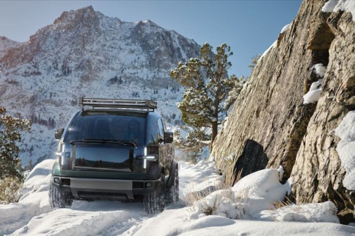 rendering of pickup truck driving through snowy, mountainous region