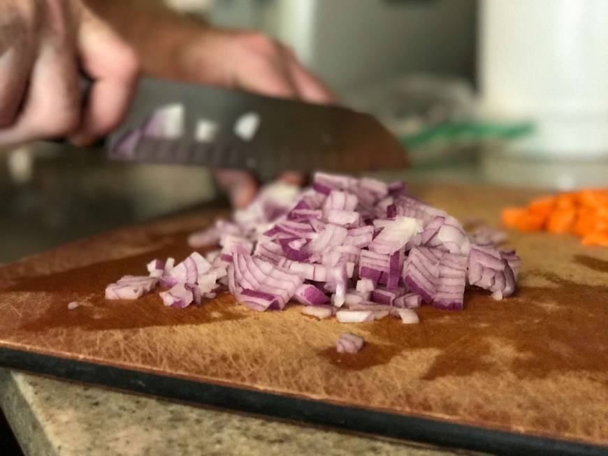 Chop one small red onion for the chicken pot pie.