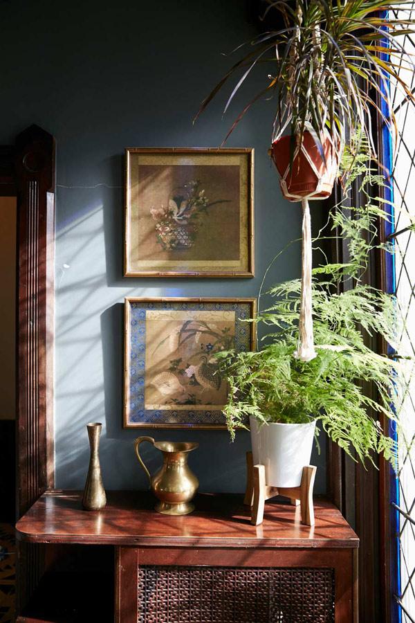 Jess Davis, owner of Nest Studio, sun room in her South Orange NJ Victorian