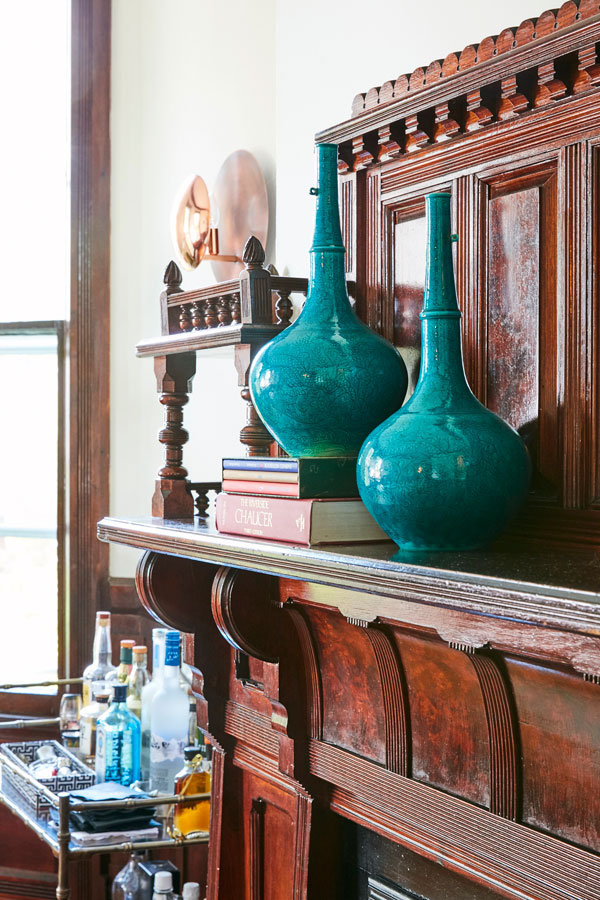 Jess Davis, owner of Nest Studio, teal vases in the dining room in her South Orange NJ Victorian