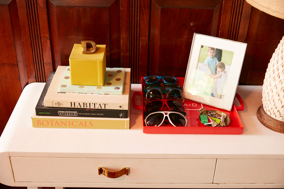 Jess Davis, owner of Nest Studio, a vignette of her families sunglass obsession in her South Orange NJ Victorian