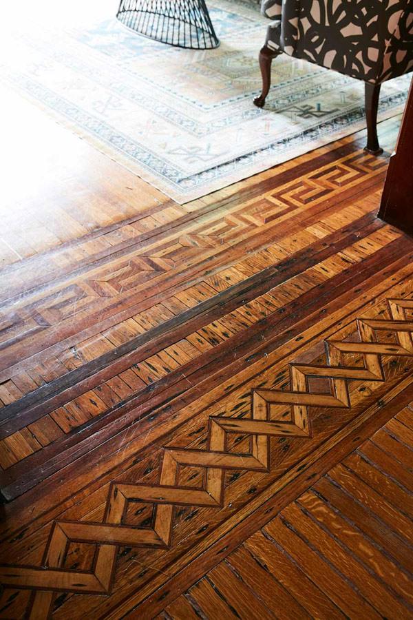 Jess Davis, owner of Nest Studio, original wood floor design in her South Orange NJ Victorian