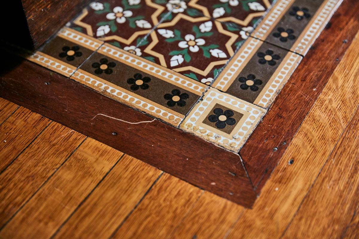 Jess Davis, owner of Nest Studio, original hearth tile in her South Orange NJ Victorian