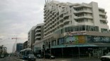 Brighton-Le-Sands. The Novotel building has been there for years but Bay Street is rapidly becoming highrise central.