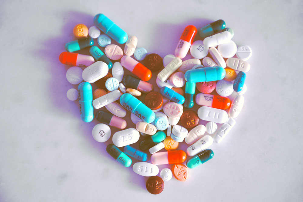 A compiled bunch of pills shaped into a heart