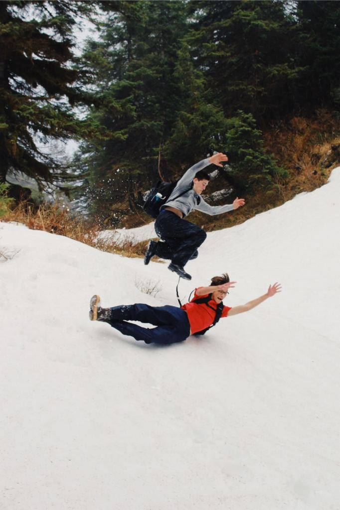 sliding down snow hill