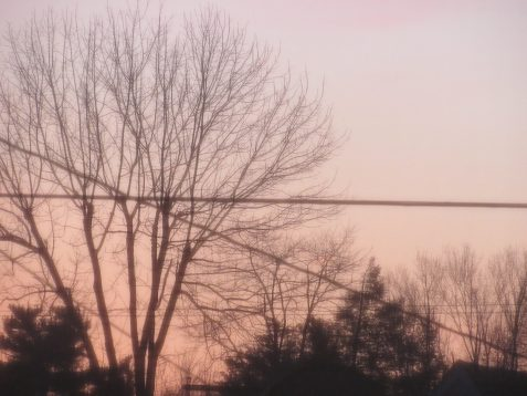 Photo of sunset with crossed cables