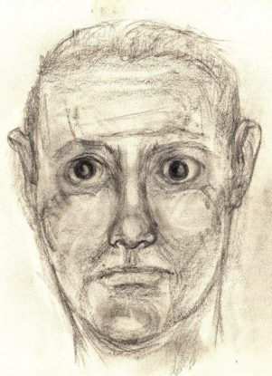 The German Spy scarred male face with glass eye art for poem The Assassin Comes