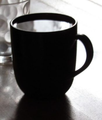 photo cup of coffee reflecting white light art for poem Ambition