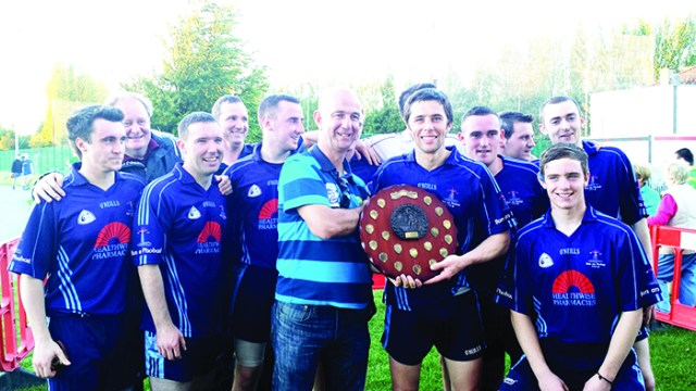 Seamus Hegarty is presented with the All Ireland 7s shield.