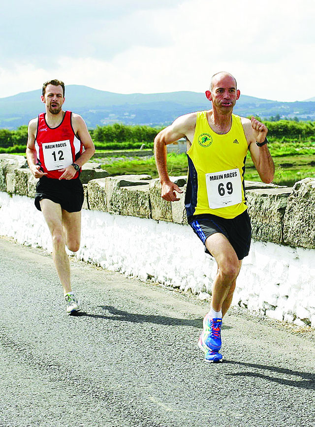 page 3-Joe McKinney and Eoghan Furey stride it out during last year's Malin Mile