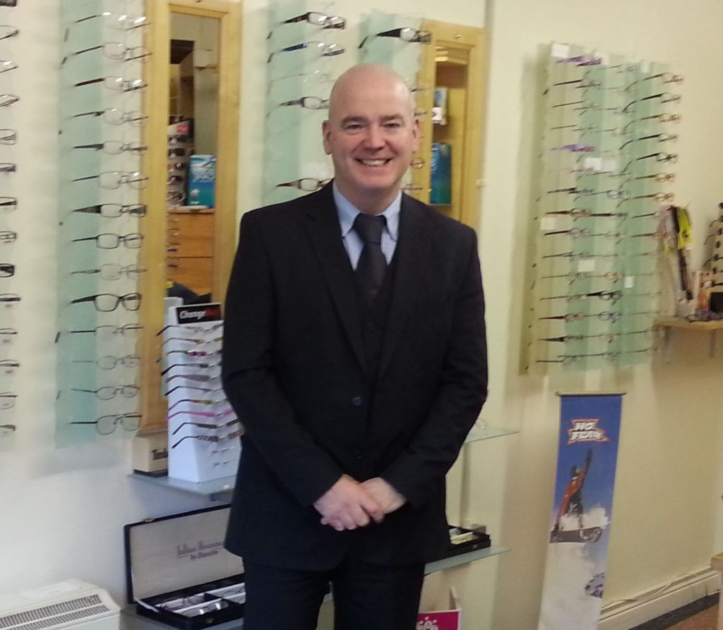The late Jeffrey McLaughlin pictured in his Buncrana optician business, one of two he owned in Inishowen.