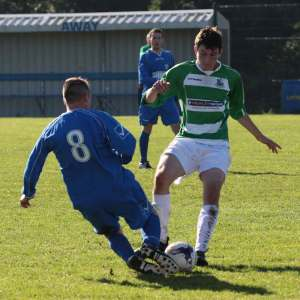 Moville Celtic's Finn McLaughlin takes on Seamus O'Donnell from Aileach Reserves