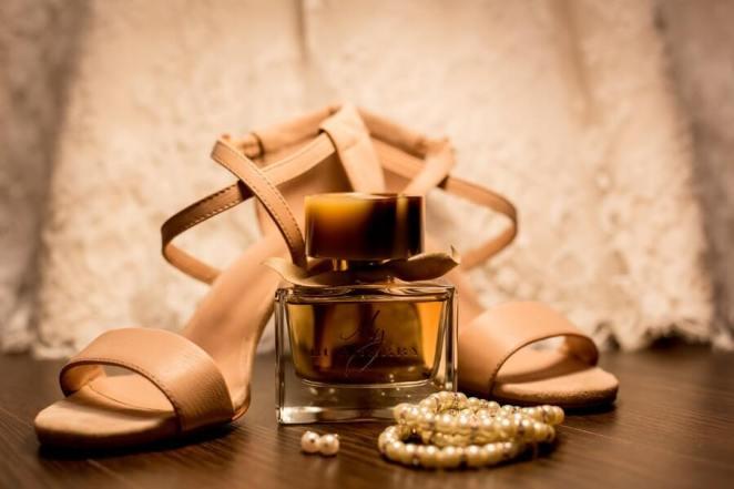 Pearl Bracelets Beside a Fragrance Bottle