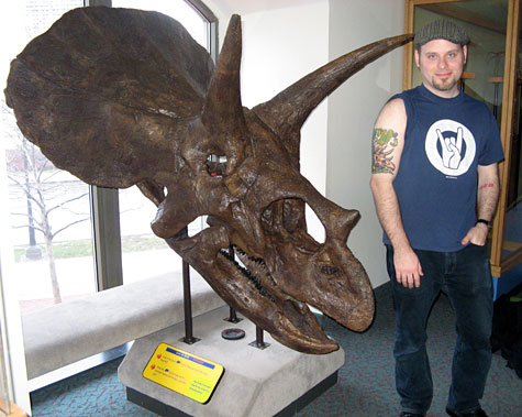 Josh and a triceratops skull fossil in Philadelphia.