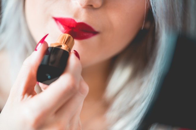 young-smiling-woman-applying-red-lipstick-picjumbo-com