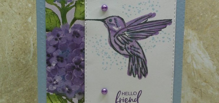 Hydrangeas and Hummingbirds: Hello friend card with Hydrangea Hill Designer Series Paper. This handmade card has a base of Seaside Spray card stock, dry embossed with the Tasteful Textile embossing folder. The sentiment in Gorgeous Grape ink and the Highland Heather hummingbird are from A Touch of Ink stamp set. A couple large Pastel Pearls accent the stamped images for a beautiful and easy card.