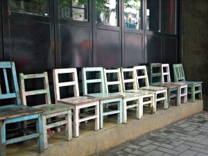 chairs lining a street; first newsletters