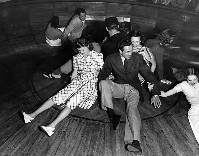 Film players at the Venice Pier Fun House in 1940. As the bowl spins, people fight for leverage to stay in the center.
