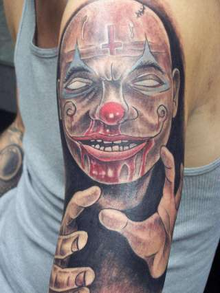 black-light-clown-tattoo-on-bicep