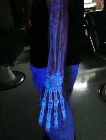 blacklight-skeleton-arm-tattoo