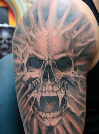 skull-vampire-tattoo-design-for-men-on-sleeve