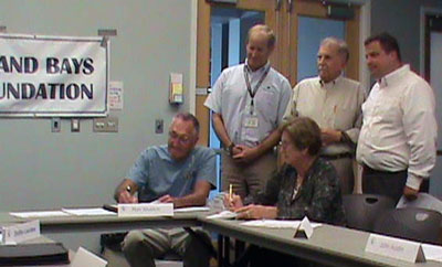 Fig. 8, signing the FOHLSP MOU (photo by Dottie LeCates) The signers are, left to right: Ron Wuslich, Shirley Price, and Ray Bivens,