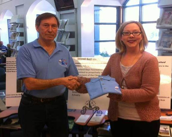 Fig. 6 IBF VP Henry Glowiak presenting an IBF shirt to Assistant Director Jessica Prayer