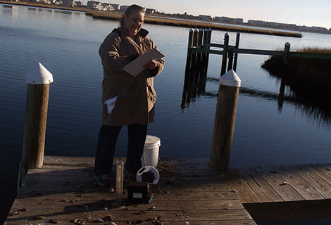 Frances Hart doing routine water tests at Quillens Point.