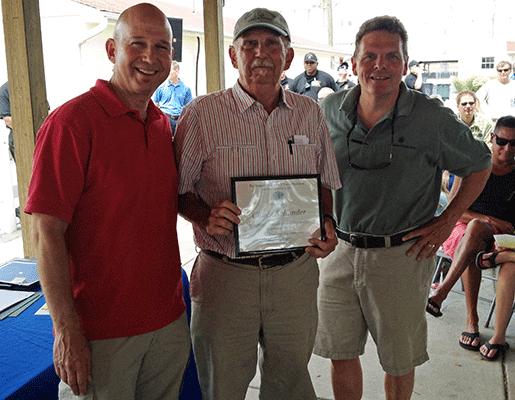 Gov. Markell giving DNREC Volunteer award to Chuck Schonder--also pictured is David Small, DNREC Secretary.