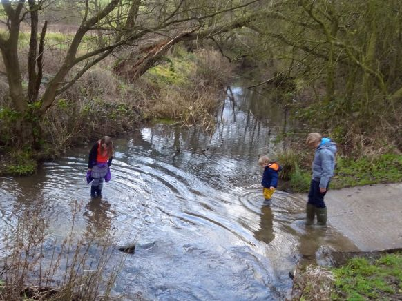 With all the sticks thrown, it's time to fill our wellies with freezing water!